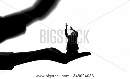 Silhouette Of Woman Holding Tiny Man, Female Authority, Dominance Manipulation