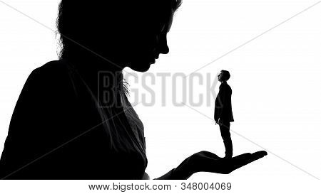 Shadow Of Female Holding Tiny Man In Love In Hand, Women Power, Domination
