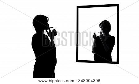 Pregnant Woman Smoking Cigarette, Looking In Mirror, Conscience Asking To Stop