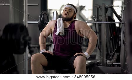 Male In Gym Pretending To Be Athletic, Sitting As Macho, Workout Motivation