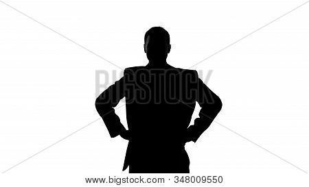 Silhouette Of Businessman Holding Hands On His Hip, Seriousness Of Intentions