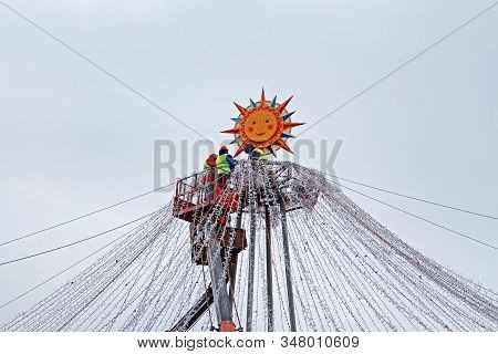 Moscow, Russia - February 27, 2019: Workers Decorate Manezhnaya Square With Electric Garlands For Ru