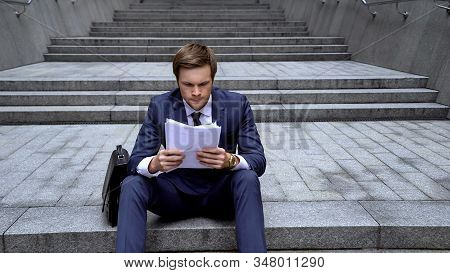 Office Worker Analyzing Contract, Angry About Unsuccessful Deal, Fraudulent Data