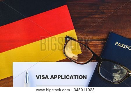 Flag Of Germany , Visa Application Form And Passport On Table