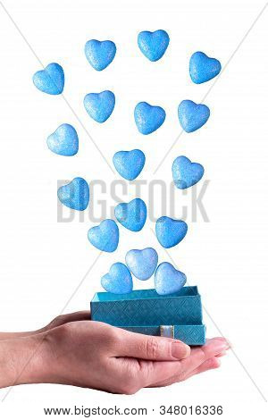 Girl Holds A Gift Box With Blue Hearts. Valentine's Day.
