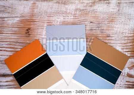 Three Multicoloured Swatches On Wooden Background. Close-up.