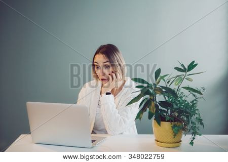 Happy Surprised Caucasian Business Woman Working On Laptop Computer. Freelancer Working Remotely On