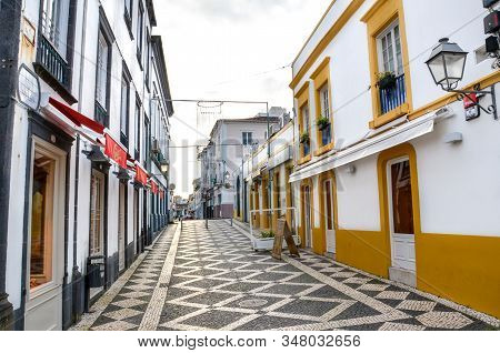 Ponta Delgada, Azores, Portugal - Jan 12, 2020: Empty Street With Bars And Restaurants In The Histor