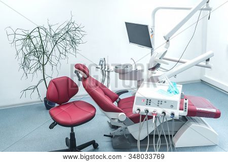 Interior Of New Modern Dental Clinic Office With Dental Unit, Medical Equipment And Stomatology Conc