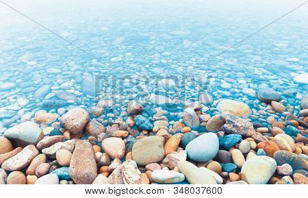 River Stones Or Pebbles On The River Shore And Water.abstract Water And Nature Background