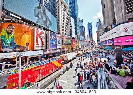 Times Square, New York, USA: April 2015; Daytime scene of a busy Times Square