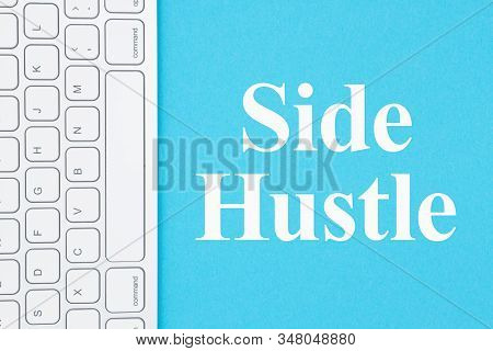 Side Hustle Message With Gray Keyboard On A Blue Background