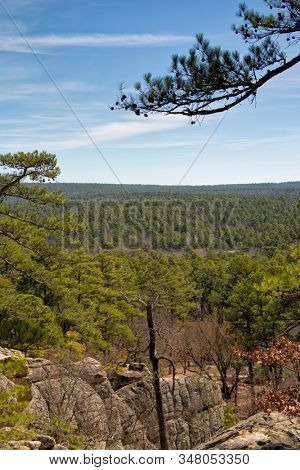 View across rock formations and pine treetops at Robbers Cave, Oklahoma