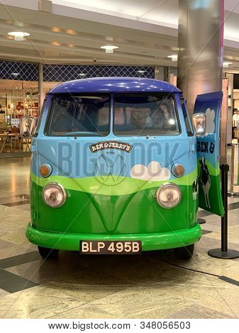 Southampton, UK - 16 January 2020: VW camper van converted to a Ben and Jerry's Ice Cream van decorated with a grass and blue sky design, in West Quay shopping mall, Southampton, UK