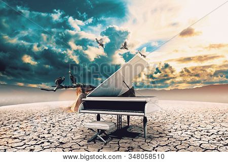 Piano In Nature..surreal Image Related To Piano Music,song And Melody.sunset And Dry Soil Scenic Lan