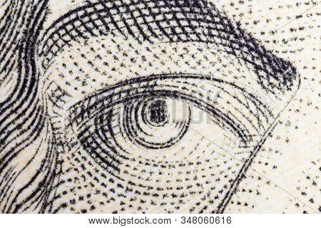Macro close uo photograph of Alexander Hamilton eye on the US ten dollar bill.