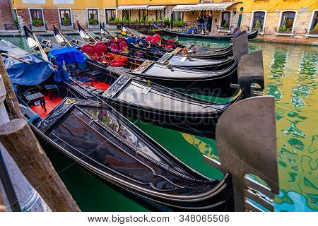 May 10, 2019. Venice, Italy. Narrow Canal With Gondola And Bridge In Venice, Italy. Architecture And
