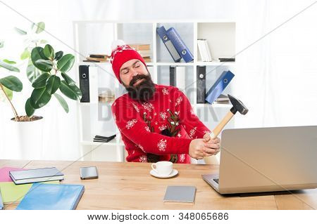 Festive Stress. Busy Man Hit Laptop With Hammer. Got Stress At Work. Stressful Work. Christmas Stres