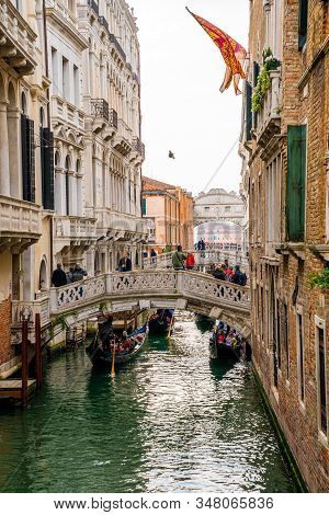 May 20, 2019. Venice, Italy. Narrow Canal With Gondola And Bridge In Venice, Italy. Architecture And