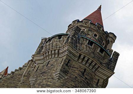 Toronto, Canada - 06 20 2016: Casa Loma Building Before A Dark Cloudy Sky. Casa Loma Is A Gothic Rev