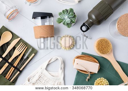 Flat Lay Of Zero Waste Kit. Set Of Eco Friendly Bamboo Cutlery, Mesh Cotton Bag, Reusable Coffee Tum