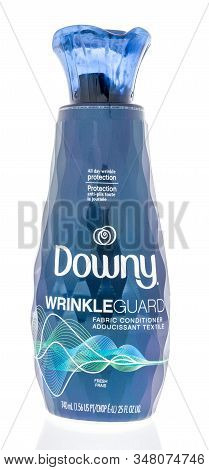 Winneconne, Wi - 19 January 2019 : A Bottle Of Downy Wrinkle Guard Fabric Conditioner On An Isolated