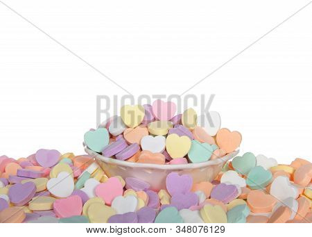 Porcelain Bow With Heart Cutouts Holding Pile Of Large Pastel Candy Hearts Surrounded By Pile Of Mor