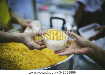 Beggars Receive Warm And Delicious Food From The Donor's Hands: The Concept Of Food Beggars