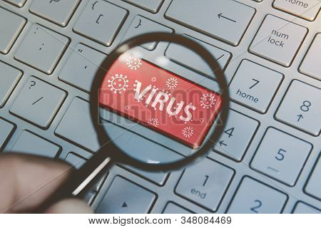 Computer Virus From Internet, With Message On Enter Key Of Keyboard. Red Button With A Picture Of Th