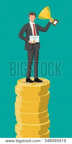 Businessman Holding Trophy, Showing Award Certificate Celebrates His Victory. Stacks Of Golden Coins