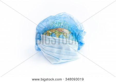 Earth Planet In Protective Medical Mask Isolated On White Background. Novel Rapidly Spreading Corona