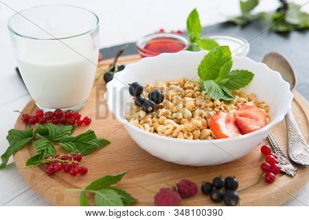 Tasty Cornflakes With Berries On Wooden Background Healthy Tasty Breakfast Of Muesli With Strawberri