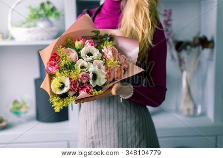 Florist Holding A Bouquet. Beautiful Spring Flowers. Arrangement With Mix Flowers. The Concept Of A