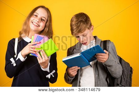 Exercise Books Ready For School Ahead. Small Children Hold Note Books. Little Girl And Boy With Acti