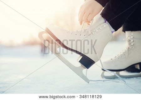 Preparing Girl For Figure Skating On White Skates For Winter Ice Rink. Sunlight, Place For Text. Con