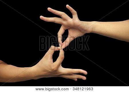 Isolated Hands Of Male Teenage Boy Doing Dharmachakra Yoga Mudrawith Two Hands. Horizontal Shot Of M