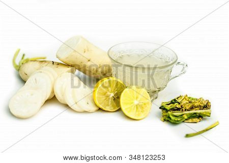 Detoxifying Daikon Radish Tea In A Transparent Glass Cup Isolated On A White Background.horizontal S