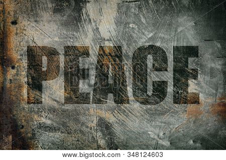 Peace written on messy steel background
