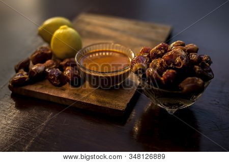 Date Fruit Face Mask In A Glass Bowl Consisting Of Some Dates And Lemon Juice For Oily Skin. The Hor
