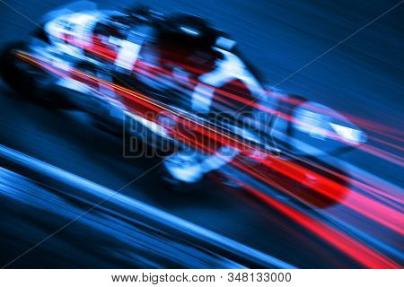 Motion blur motorbike in blue and red