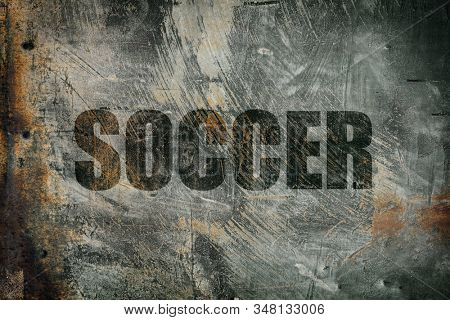Soccer written on messy steel background