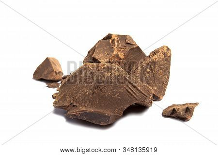 Raw 100% Pure Organic Cacao Chocolate Piece Isolated On White With Shadow. Theobroma Cacao Mass Or P