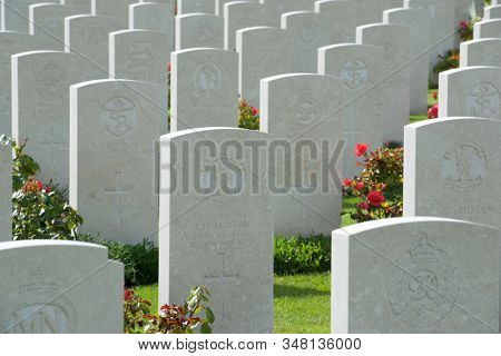 Bayeux, France - August 20, 2014: Headstones lined up in the British cemetery