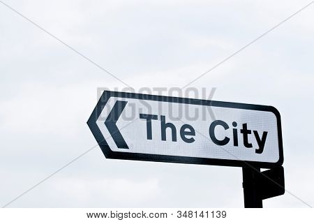 City street sign and cloudy sky