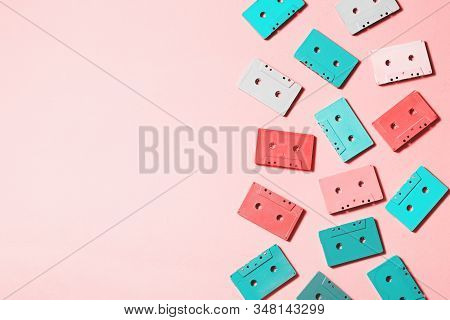Painted Audio Cassettes In Bright Colors And Blue Earphones On Pastel Background, Copy Space, Top Vi