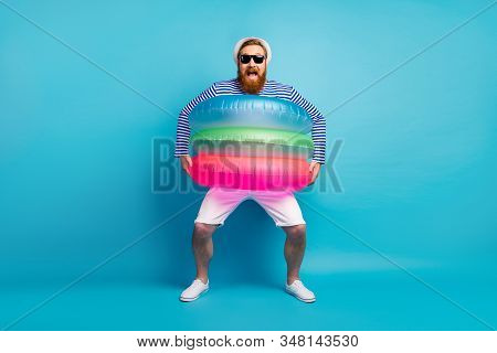 Full Size Photo Of Funky Cheerful Crazy Man Tourist Enjoy Rejoice Scream Hold Colorful Life Buoy Wea