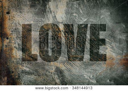 Love written on messy steel background