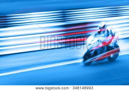 Motion blur of motorcycle in blue