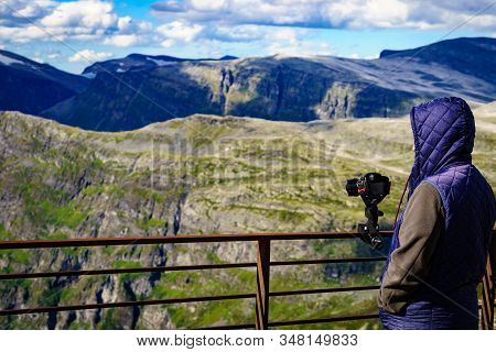 Male Tourist Taking Photo With Camera, Enjoying Mountains Landscape From Dalsnibba Area Geiranger Sk