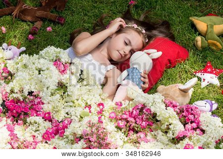 girl lying on the grass under a blanket of flowers